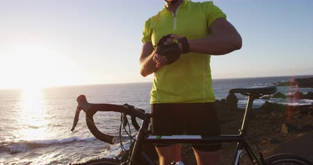 helm : Sport Smartwatch. Cyclist biking looking at smartwatch cycling riding road bike. Athlete biker using activity tracker gps fitness watch on workout. Sports man using his watch app for fitness tracking.