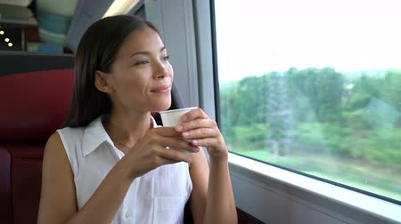 metro : Asian woman traveling in train drinking morning coffee on commute to work. Businesswoman on travel commuting to work in business class.