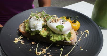 poached egg : Avocado toast with poached egg - traditional hipster breakfast or brunch meal.