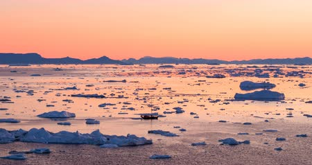 ilulissat : Ice and Icebergs from glacier - amazing arctic nature landscape aerial video of icefjord filled with icebergs from melting glacier Sermeq Kujalleq, Ilulissat, Greenland. Midnight sun. Stock Footage