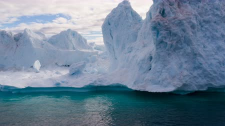 disko bay : Iceberg aerial footage - giant icebergs in Disko Bay on greenland floating in Ilulissat icefjord from melting glacier Sermeq Kujalleq Glacier, aka Jakobhavns Glacier. Global warming and climate change Stock Footage