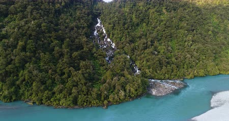roaring : New Zealand nature landscape aerial drone video of Haast River and Roaring Billy Falls waterfall in Mount Aspiring National Park, South Island, New Zealand. Stock Footage