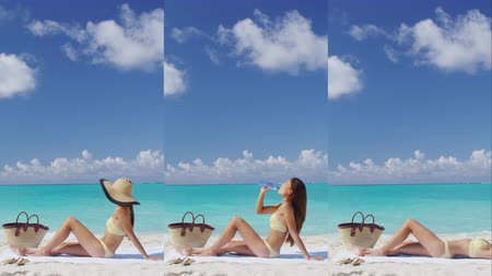 suntan : Vertical video of Suntan woman lying down relaxing getting a bikini sun tan on Caribbean beach summer vacation travel destination. Sexy Asian woman with slim body for weight loss concept. Stock Footage