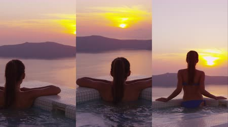 джакузи : Vertical Video of Woman In Swimming Pool Spa Enjoying Sunset On Over Sea Luxury Vacation Travel On Santorini, Greece, Europe. Girl in bikini watching beautiful view of sunset on holidays at resort.