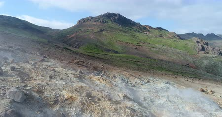 güneybatı : Iceland nature landscape drone footage of geothermal fields showing volcanic activity of active volcano fumaroles. Seltun geothermal field in Krysuvik on Reykjanes peninsula, South West Iceland.
