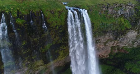 golden circle : Aerial drone footage of waterfall Seljalandsfoss on Iceland in Icelandic nature. Famous tourist attractions and landmarks destinations in Icelandic nature landscape on the ring road, South Iceland.