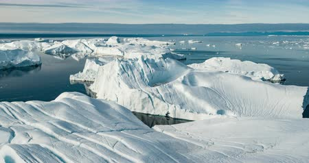 ilulissat : Iceberg aerial footage - giant icebergs in Disko Bay on greenland floating in Ilulissat icefjord from melting glacier Sermeq Kujalleq Glacier, aka Jakobhavns Glacier. Global warming and climate change Stock Footage