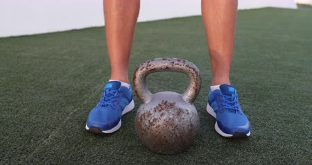 pull out : Kettlebell weightlifting fit man lifting crossfit weight at outdoor gym for squat leg workout. Real time 29.97 FPS. See other exercises.