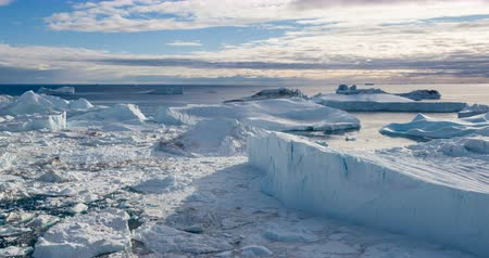 ilulissat : Global warming - Greenland Iceberg landscape of Ilulissat icefjord with giant icebergs. Icebergs from melting glacier. Arctic nature heavily affected by climate change