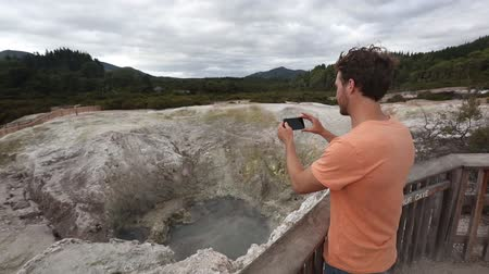 champagne pool : New Zealand travel tourist taking phone picture of famous attraction, Waiotapu. Active geothermal area, Okataina Volcanic Centre, Reporoa, in Taupo Volcanic Zone, Rotorua, north island.