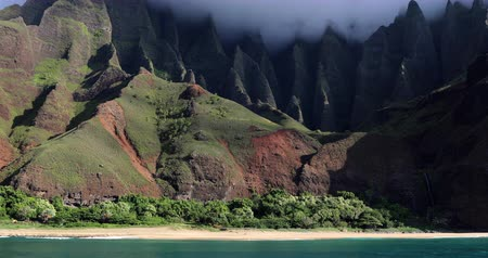 pacific islands : Hawaii, Kauai famous Na pali coast beach view from water. Famous Hawaiian travel destination. Napali coastline in Kaui, Hawaii, USA, the Honopu arch. Majestic awesome landscape.