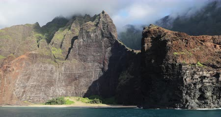 pacific islands : Hawaii beach, Kauai. Na pali coast view from water. Famous Hawaiian travel destination. Napali coastline in Kaui, Hawaii, USA,