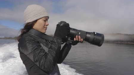 alaszka : Photographer and Alaska tourist enjoying travel vacation cruise excursion in Misty Fiords National Monument (aka Misty Fjords) taking pictures photographing the wildlife travel adventure in Alaska. Stock mozgókép