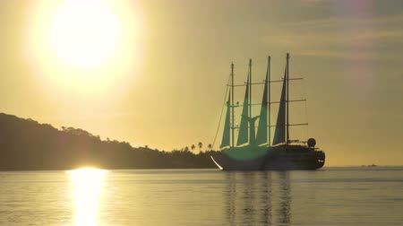 bora bora : Cruise ship passenger luxury yacht sail boat sunset at tropical tourist destination. Tender boat transporting tourists on cruise ship excursions. From Bora Bora, French Polynesia, Tahiti. Stock Footage
