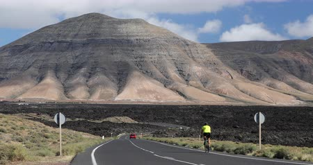 bisikletçi : Man cyclist biking on road race cycling on racing bike. recreational cyclist athlete cycling riding bicycle on Lanzarote, Canary Islands, Spain, Europe. Stok Video
