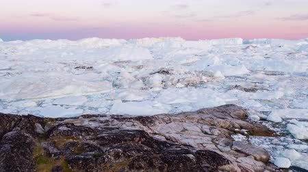 iceberg : Iceberg and ice from glacier in arctic nature landscape on Greenland. Aerial video drone footage of icebergs in Ilulissat icefjord. Affected by climate change and global warming. Breathtaking nature. Stock Footage