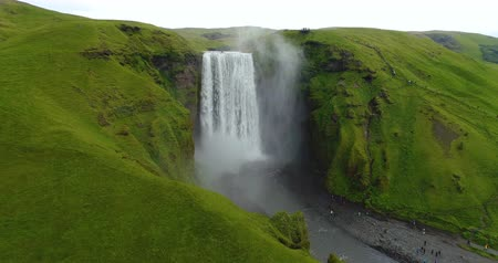 skogafoss : Skogafoss waterfall on Iceland - aerial drone video of Icelandic landscape. Famous tourist attractions and landmarks destinations in Icelandic nature on South Iceland. 4K UHD video.