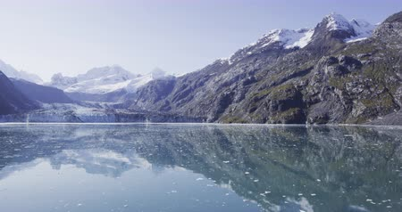 alasca : Glacier Bay with Johns Hopkins Glacier seen from cruise ship - Alaska cruise travel landscape. Summer cruise ship vacation in Alaska, USA. SLOW MOTION shot on RED cinema Camera.