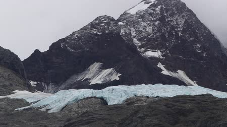 Glacier on mountain in Glacier Bay National Park in Alaska. Glaciers in Alaska are affected by Global Warming and Climate Change. Cruise ship travel tourist destination. Shot in 59.94 FPS Slow motion