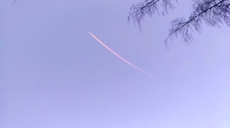 Airplane trail high in the sky. The plane takes off. Taking off. Night. Spring.