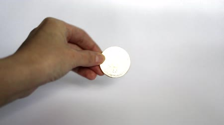 Cryptocurrency concept golden bitcoin. A woman holds a gold coin - bitcoin. White background. Stock Footage