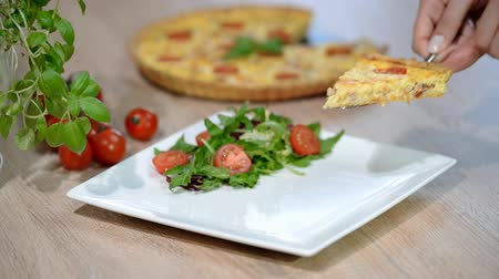 quiche : Quiche Lorraine with salad. Put a piece Quiche Lorraine in a white plate
