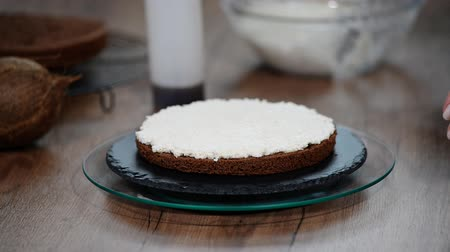 cheese slices : Cooking cake. Chocolate sponge cake with cream. Pastry bag