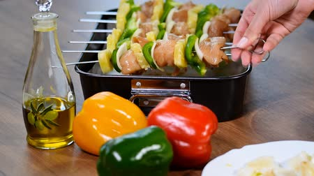 chicken pieces : Raw chicken shashlik on skewers for a festive meal