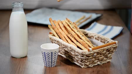 breadstick : Homemade whole wheat grissini. Traditional Italian snack. Stock Footage