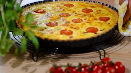 there : Quiche Lorraine pie with tomatoes.