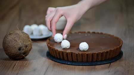 orzechy laskowe : Decorated chocolate coconut tart with candy.
