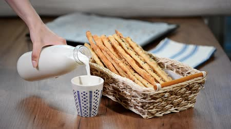 bread stick : Freshly baked, rustic Italian grissini bread sticks with milk
