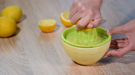 squeezer : Squeezing fresh lemon juice into bowl. Stock Footage
