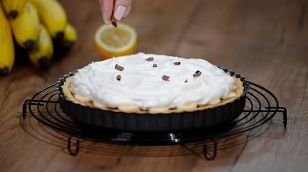 baking dishes : Banoffee pie with bananas, whipped cream, chocolate. Cutting piece banoffee pie. Stock Footage