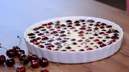 tejföl : Baked red cherry clafoutis with cream.
