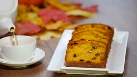 baked pumpkin : Slices of pumpkin loaf and cup of tea.