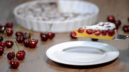 charlotte pie : Cherry clafouti - traditional french sweet fruit dessert clafoutis with cherries. Stock Footage