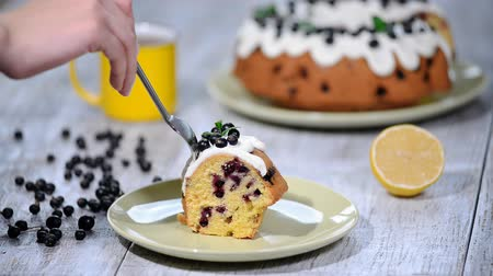 baking dishes : Delicate delicious cake with black currant. Eating a piece of cake with black currant.