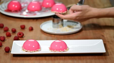 indulgência : French raspberry mousse cake with pink mirror glaze.