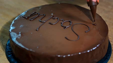 pralina : Chocolate cake Sacher on a wooden table.