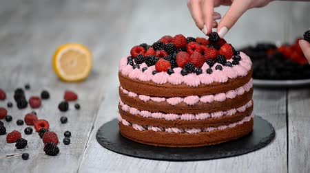 turta : Chef decorate the cake wild berries.