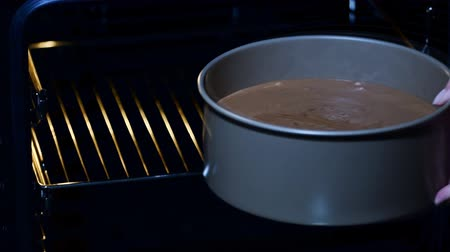 concoction : Raw chocolate cake in confectionery form put in the oven.
