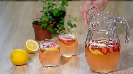 pitcher : Lemonade with fresh srtawberries, lemons and ice
