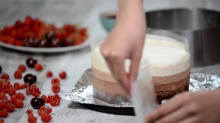 cheese slices : Making homemade Three Chocolate Mousse cake.