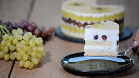 yang : Piece homemade mousse cake with grapes.