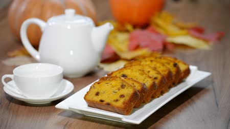 pumpkin pieces : Put in plate sliced sweet pumpkin bread. Pour tea in cup.