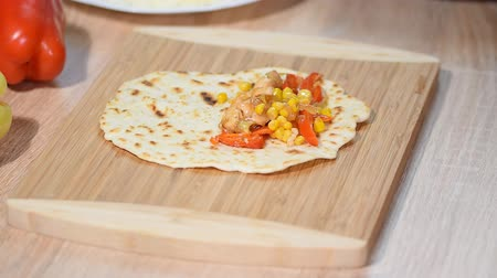 capsicum : Process of cooking quesadilla. Cooking for healthy fresh quesadilla, tacos, buritto, fajitas. Stock Footage