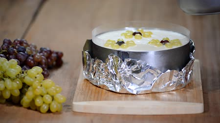 souffle : Pouring jelly on the cake. Making mousse cake with grapes. Cooking process.