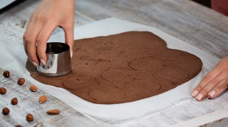 baking ingredient : Making Chocolate Cookies. Series. Using cookie cutters to cut out rounds.