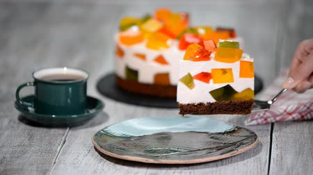 домовой : Cake with colored jelly. A piece of cake Broken Glass. Стоковые видеозаписи